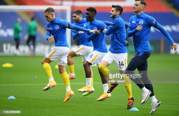 Leandro Trossard Neal Maupay Yves Bissouma Adam Lallana and Ben White of Brighton and Hove Albion warm up prior to the Premier League match between...