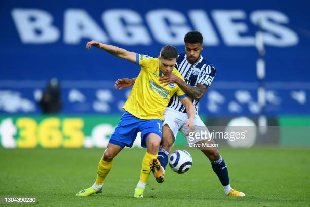 Leandro Trossard of Brighton and Hove Albion battles for possession with Darnell Furlong of West Bromwich Albion during the Premier League match...