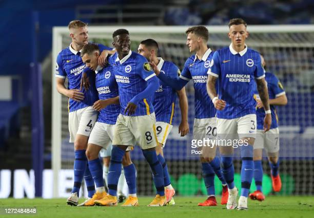 Leandro Trossard of Brighton and Hove Albion celebrates with teammates after scoring his sides first goal during the Premier League match between...