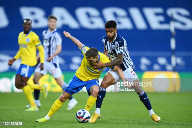 Leandro Trossard of Brighton and Hove Albion is challenged by Darnell Furlong of West Bromwich Albion during the Premier League match between West...