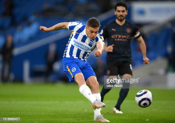 Leandro Trossard of Brighton and Hove Albion scores their side's first goal during the Premier League match between Brighton & Hove Albion and...