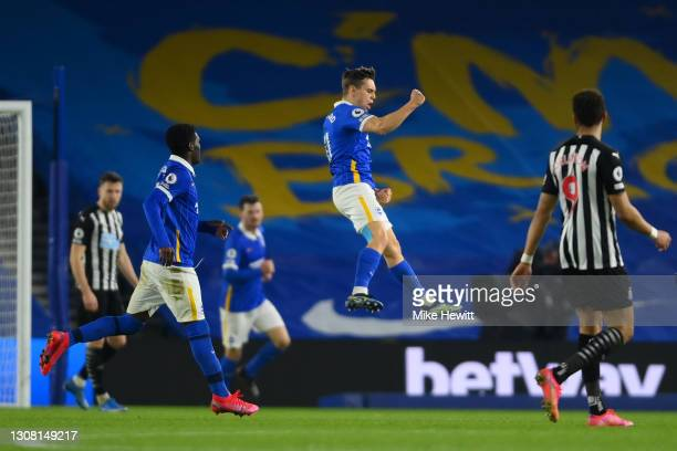 Leandro Trossard of Brighton & Hove Albion celebrates after scoring their team's first goal during the Premier League match between Brighton & Hove...