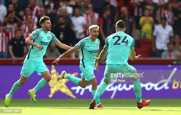 Leandro Trossard of Brighton & Hove Albion celebrates after scoring their side's first goal during the Premier League match between Brentford and...