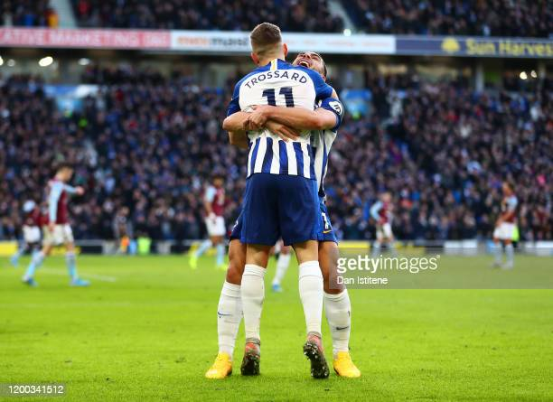 Leandro Trossard of Brighton Hove Albion celebrates with Neal Maupay after scoring his team's first goal during the Premier League match between...