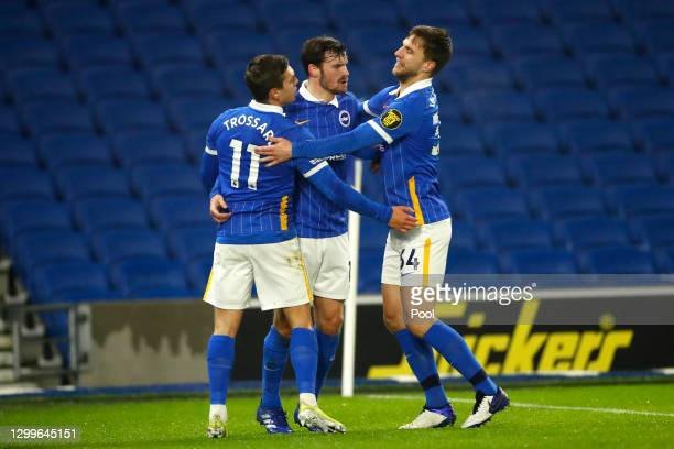 Leandro Trossard of Brighton & Hove Albion celebrates with team mates Pascal Gross and Joel Veltman after scoring their side's first goal during the...
