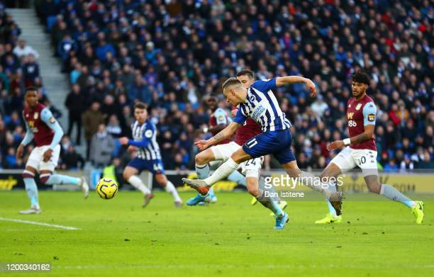 Leandro Trossard of Brighton & Hove Albion scores his team's first goal during the Premier League match between Brighton & Hove Albion and Aston...