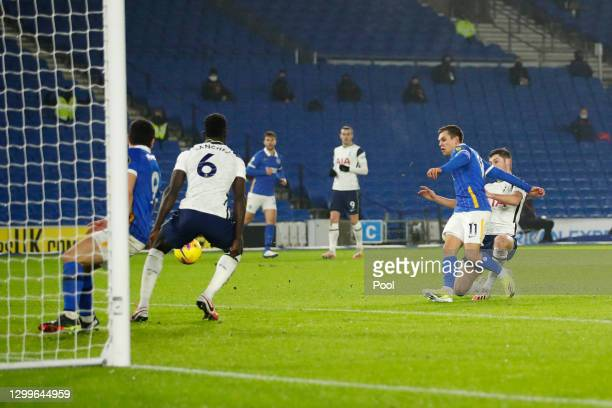 Leandro Trossard of Brighton & Hove Albion scores their side's first goal whilst under pressure from Ben Davies of Tottenham Hotspur during the...