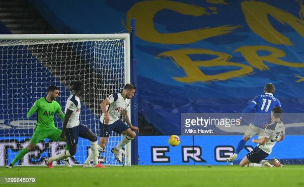 Leandro Trossard of Brighton & Hove Albion scores their side's first goal past Hugo Lloris of Tottenham Hotspur whilst under pressure from Ben Davies...