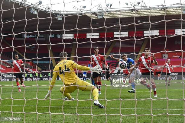 Leandro Trossard of Brighton & Hove Albion shoots past Fraser Forster of Southampton to score his team's 2nd goal during the Premier League match...