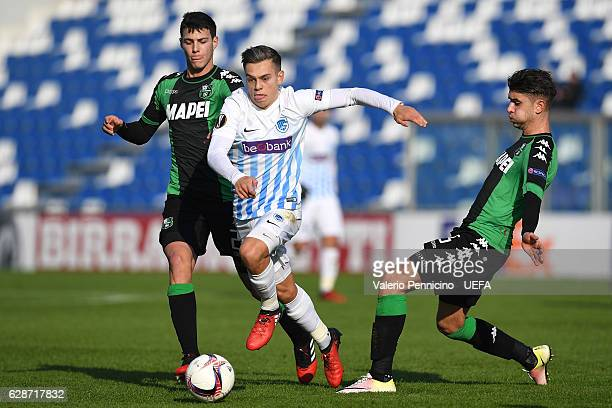 Leandro Trossard of KRC Genk is challenged by Luca Mazzitelli and Luca Antei of US Sassuolo Calcio during the UEFA Europa League Group F match...