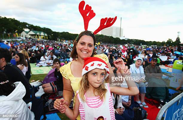Leane Kingston and her daughter Christiana enjoy the live music during CocaCola Christmas In The Park at Auckland Domain on December 13 2008 in...