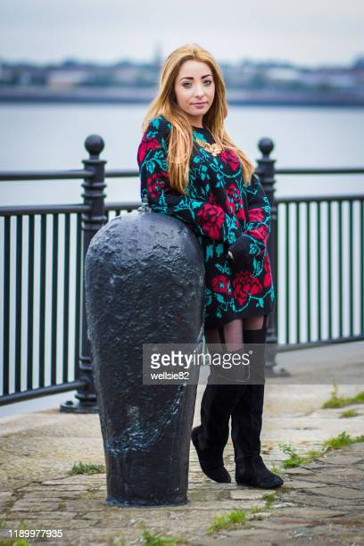 leaning against a mooring bollard - models in stockings stock pictures, royalty-free photos & images