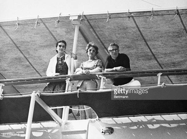 Leaning on the rail of the yacht, Christina, , is opera star Maria Callas, and a woman believed to be Artemis Onassis, sister of Aristotle, along...