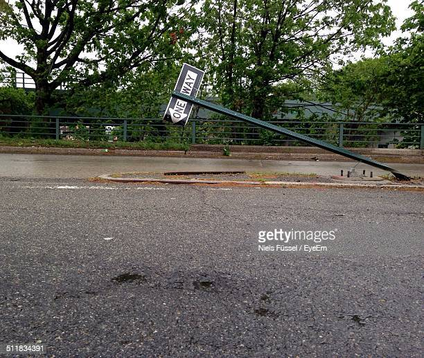 Leaning one way signboard