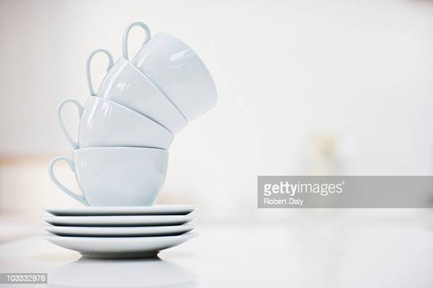 leaning stack of coffee cups - saucer stock pictures, royalty-free photos & images