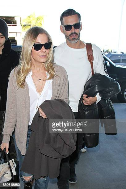 LeAnn Rimes and Eddie Cibrian are seen at LAX on December 28 2016 in Los Angeles California