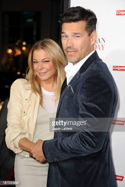 LeAnn Rimes and Eddie Cibrian attend the premiere of The Best Man Holiday at TCL Chinese Theatre on November 5 2013 in Hollywood California