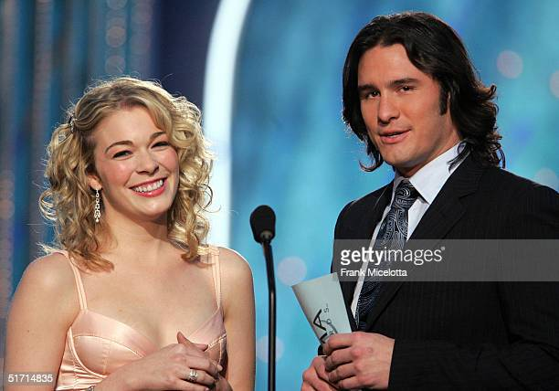 LeAnn Rimes and Joe Nichols present an award on stage at the 38th Annual CMA Awards at the Grand Ole Opry House November 9 2004 in Nashville Tennessee
