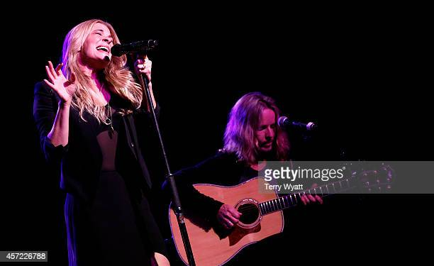 LeAnn Rimes and Tommy Shaw of Styx perform at Inspire Nashville 2 A Celebration for Possibilities Inc at Marathon Music Works on October 14 2014 in...