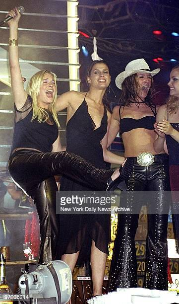 LeAnn Rimes Bridget Moynahan and a Coyote girl onstage at Roseland during party for the premiere of Coyote Ugly