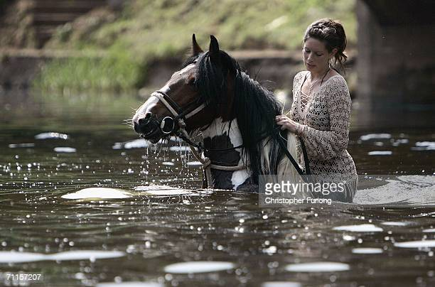 Leanna Bishop of Gloucestershire washes her horse in the River Eden at the Appleby Horse Fair on June 8 2006 in ApplebyinWestmorland England Appleby...