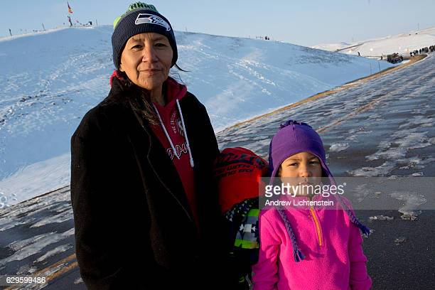 Leanna Moses a member of the Cheyenne Nation and descended from Dog Soldiers poses with her grandaughter Kionna on route 1806 Just outside of the...