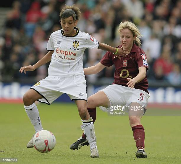 Leanne Champ of Arsenal tries to tackle Alex Scott of Leeds during the Womens FA Cup Final match between Leeds United Ladies v Arsenal Ladies at the...
