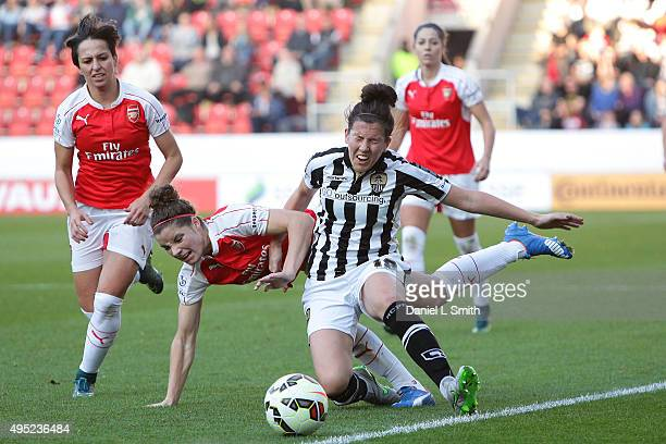 Leanne Crichton of Notts Ladies County FC falls from a tackle from Dominique Janssen of Arsenal Ladies FC during the WSL Continental Cup Final...