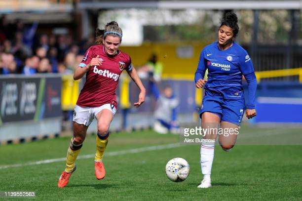 Leanne Kiernan of West Ham United and Jess Carter of Chelsea chase the ball during the FA Women's Super League match between Chelsea Women and West...