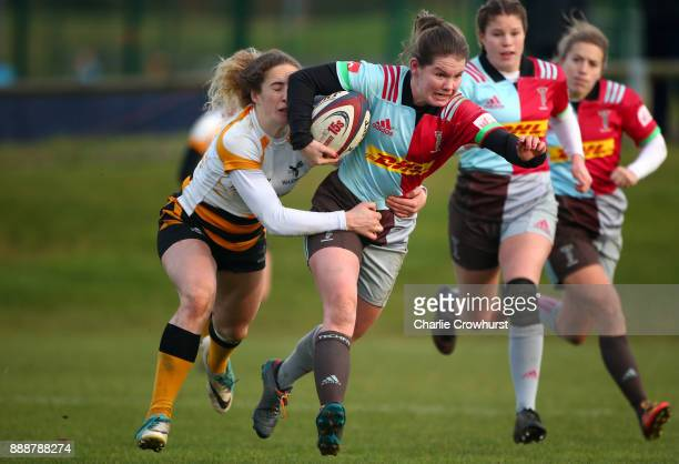 Leanne Riley of Quins holds off Wasps Abigail Dow to score the teams first try of the game during the Tyrrells Premier 15s match between Harlequins...