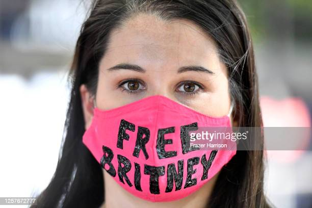 Leanne Simmons from Los Angeles gathers with supporters of Britney Spears outside a courthouse in downtown for a #FreeBritney protest as a hearing...