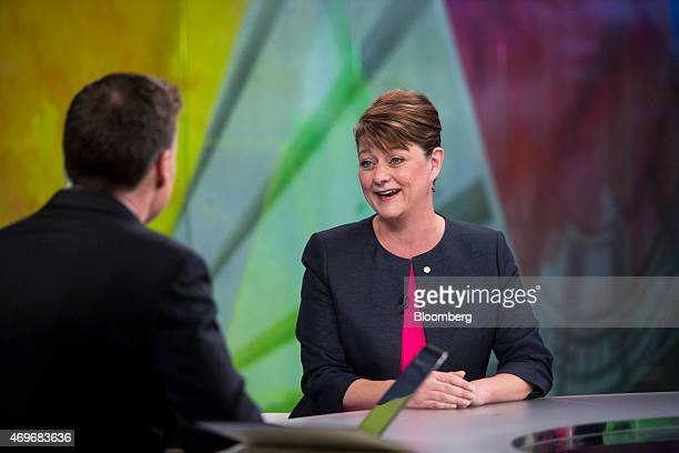 Leanne Wood leader of Welsh nationalist party Plaid Cymru right reacts during a Bloomberg Television interview in London UK on Tuesday April 14 2015...