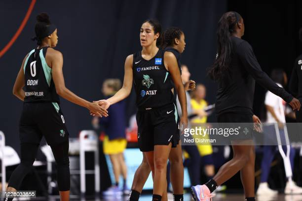 Leaonna Odom and Kia Nurse of the New York Liberty hi-five during the game against the Indiana Fever on August 13, 2020 at Feld Entertainment Center...