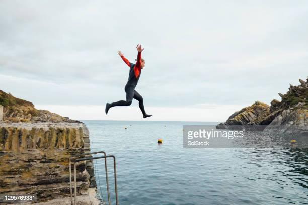 leap of faith - only men stock pictures, royalty-free photos & images