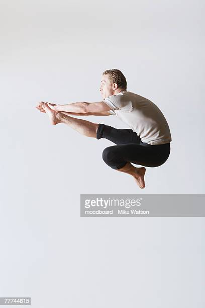 leaping ballet dancer in mid-air - male ballet dancer stock photos and pictures