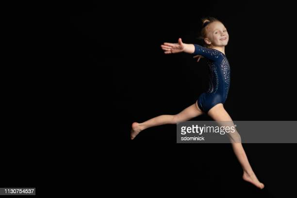 leaping gymnast - gymnastics poses stock pictures, royalty-free photos & images