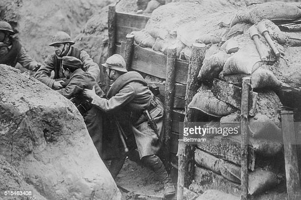 Leaping into the German trenches these French poilus capture a German In other trenches some resisted to the death others crying 'Kamerad'...