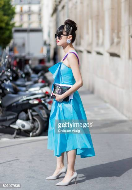 Learf Greener wearing a blue dress outside Maison Margiela during Paris Fashion Week Haute Couture Fall/Winter 20172018 Day Four on July 5 2017 in...