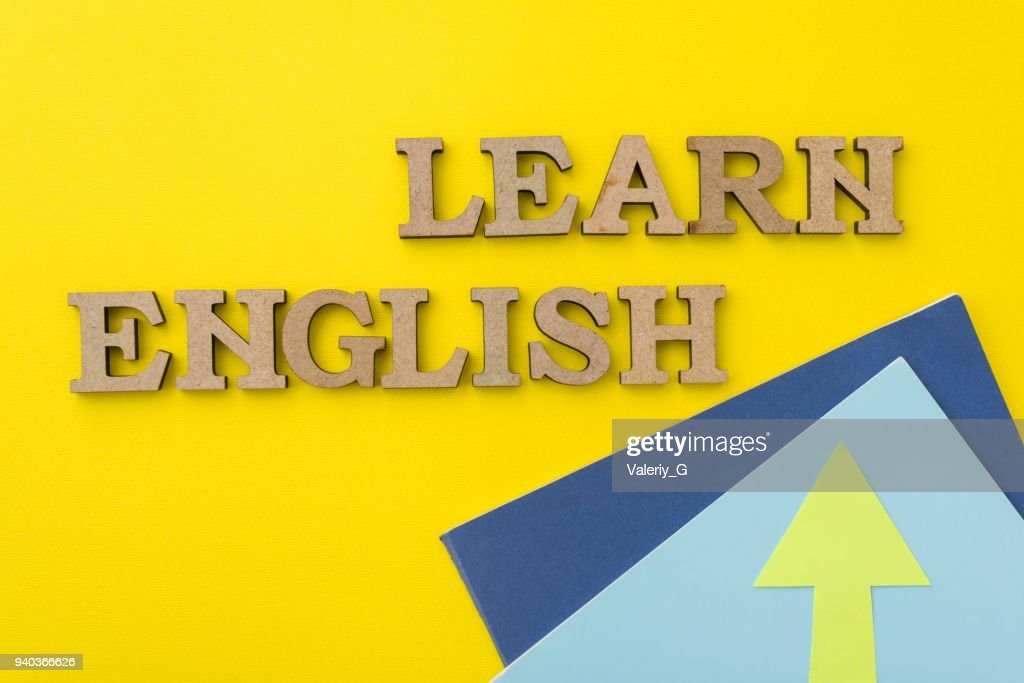 Learn English, words in wooden letters with yellow background : Stock Photo