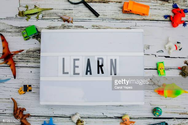 learn  word written in a light box.toys around.top view - typographies stock photos and pictures