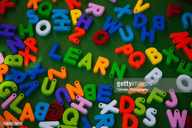 """learn"" written with alphabet toy blocks - the_writer's_block stock pictures, royalty-free photos & images"