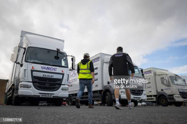 Learner driver and a driving instructor get ready for a lorry driving test at National Driving Centre in Croydon, south London on October 1, 2021. -...