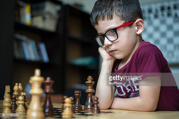A learner of the Quba Chess School plays chess during a training lesson Azerbaijan Sports schools especially chess schools are supported by the...