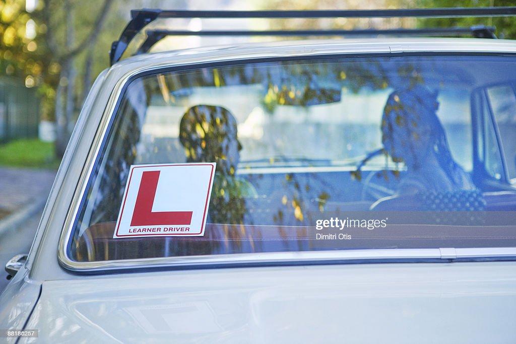learner sticker on back windscreen of car : Stock Photo