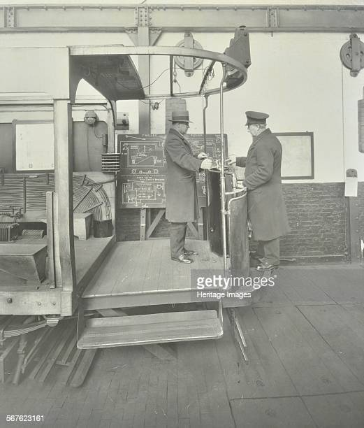 Learnerdriver under instruction in a mockup of tram car cab Wandsworth London 1932 An instructor at the Clapham Motor School stands on the bumper of...