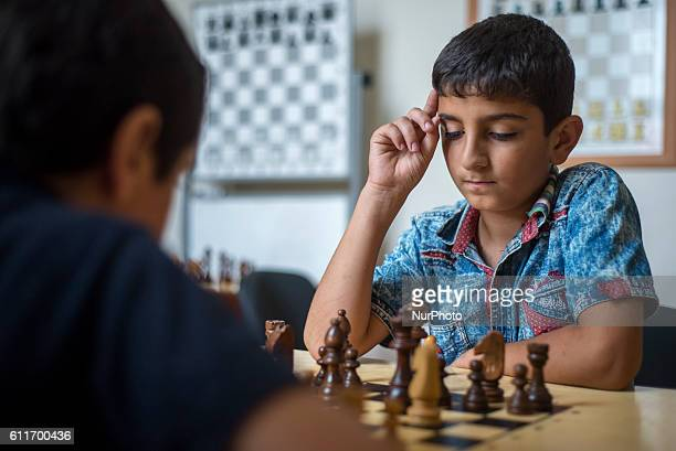 Learners of the Quba Chess School play chess during a training lesson Azerbaijan Sports schools especially chess schools are supported by the...
