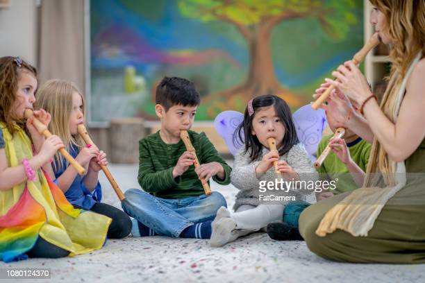 learning a musical instrument - recorder musical instrument stock photos and pictures