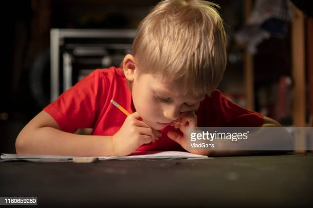 learning at home - one boy only stock pictures, royalty-free photos & images