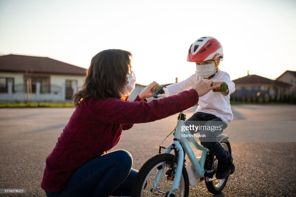 Learning bicycling during corona virus pandemic : Stock Photo