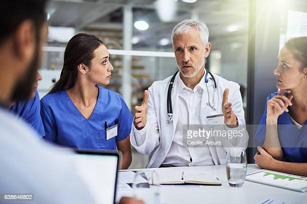learning from the best to be the best - medical team stock photos and pictures